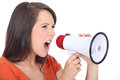 Woman screaming in speakerphone angry Royalty Free Stock Photography