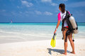 Woman in scuba diving gear on a beach Royalty Free Stock Photo