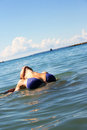 Woman in sea swimming the Stock Photography