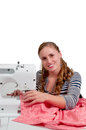 Woman seamstress beautiful with a sewing machine Stock Images