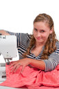 Woman seamstress beautiful with a sewing machine Royalty Free Stock Photos