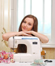 Woman seamstress work on the sewing machine Royalty Free Stock Image