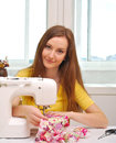 Woman seamstress work on the sewing machine Royalty Free Stock Images