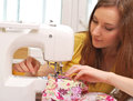 Woman seamstress work on the sewing machine Royalty Free Stock Photo