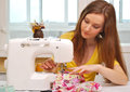 Woman seamstress work on the sewing machine Royalty Free Stock Photography