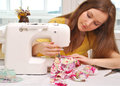 Woman seamstress work on the sewing machine Royalty Free Stock Photos