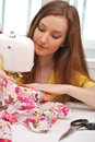 Woman seamstress work on the sewing machine Stock Photo
