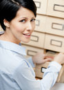 Woman searches something in card catalog Stock Images