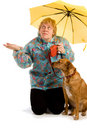 Woman seeing whether it rains Stock Image
