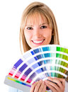 Woman selecting a color to paint Royalty Free Stock Images