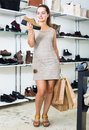 Woman selecting loafers in footgear center Royalty Free Stock Photo