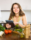 Woman selecting recipe with vegetables happy tablet in hand Stock Photography
