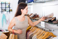 Woman selecting shoes in footgear center Royalty Free Stock Photo