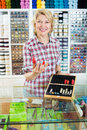 Woman seller at counter with thimbles Royalty Free Stock Photo