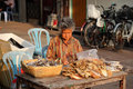Woman selling dried fish Royalty Free Stock Images