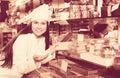 Woman selling fine chocolates Royalty Free Stock Photo