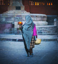 Woman selling flowers mexico a lone in mix matched old shabby clothes and shawl walks through the main plaza of san miguel de Royalty Free Stock Photo