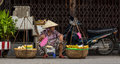 A woman selling foods on street in Hoi An, Vietnam Royalty Free Stock Photo