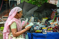 A woman selling goods on street in Kolkata, India Royalty Free Stock Photo