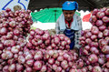 Woman selling onions