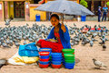 Woman sells food for pigeons around the stupa boudhnath kathmandu nepal Stock Photography