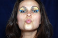 Woman is sending a kiss young for you Royalty Free Stock Image