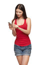 Woman sending a sms on cell phone isolated on white background Royalty Free Stock Photography