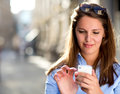 Woman sending a text message Stock Image