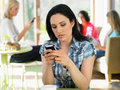 Woman sending text message in cafe busycafe Stock Photos