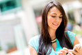 Woman sending a text message on her cell phone Royalty Free Stock Photo