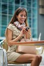 Woman sending text message on mobile phone portrait of a cheerful young Royalty Free Stock Image