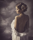 Woman fashion dress, retro hair style, naked back, historical romance portrait Royalty Free Stock Photo