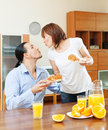 Woman serves breakfast her beloved man men at home Royalty Free Stock Image