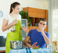Woman serving food her man at table Royalty Free Stock Photo