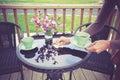 Woman setting table for tea outside Royalty Free Stock Photo