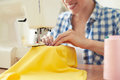 Woman sewing on sewing machine smiley focus Royalty Free Stock Images