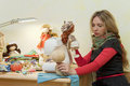 Woman sews dolls Royalty Free Stock Photos