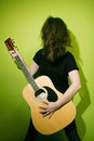 Woman shaking hair with guitar Royalty Free Stock Photo