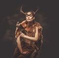 Woman shaman in ritual garment Royalty Free Stock Photo