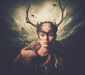 Woman shaman in ritual garment over dramatic stormy sky Royalty Free Stock Photography