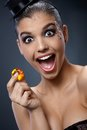 Woman in shock by gem attractive excited screaming sparkly handheld Royalty Free Stock Images