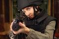 Woman shoots a rifle at the shooting range Royalty Free Stock Photo
