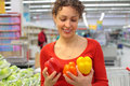 Woman in shop with sweet peppers Royalty Free Stock Photos