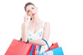Woman shopper looking up smiling and feeling pensive Royalty Free Stock Photo