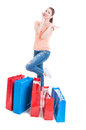 Woman shopper standing and feeling joyful with many shopping bag