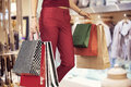 Woman shopping with bag in boutique Royalty Free Stock Photo