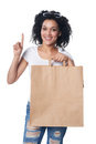 Woman with shopping bag finger up
