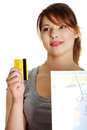 Woman with shopping bag holding credit card Stock Images