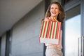 Woman with shopping bag looking on copy space Royalty Free Stock Photo