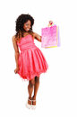 Woman with shopping bag s a lovely young jamaican holding up some isolated for white background Stock Images